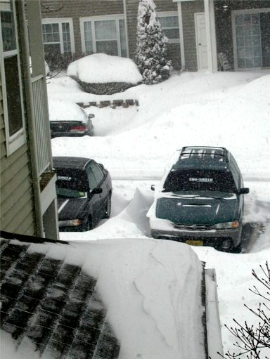 A picture snowdrift-by-a-car
